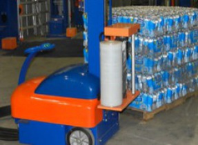 Water bottle piles being transported by manufacturing machines
